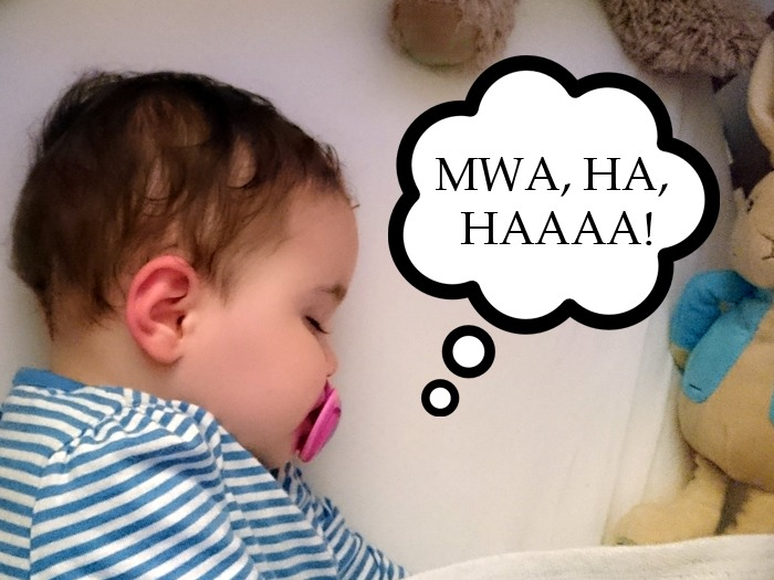 "A toddler sleeping with a thought bubble saying ""Mwa, ha, haaaa!"" superimposed. Five ways my kids outwit me while asleep."