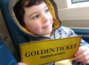A child with a golden ticket.