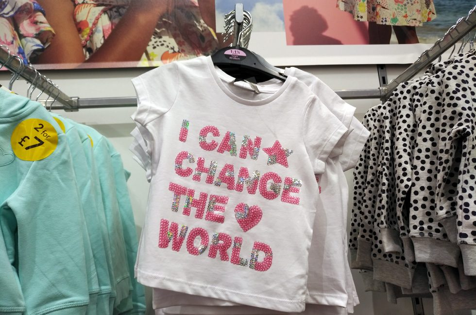 "A T-shirt with the slogan ""I can change the world"" written in pink sparkly lettering. An example of how pinkification is a problem."