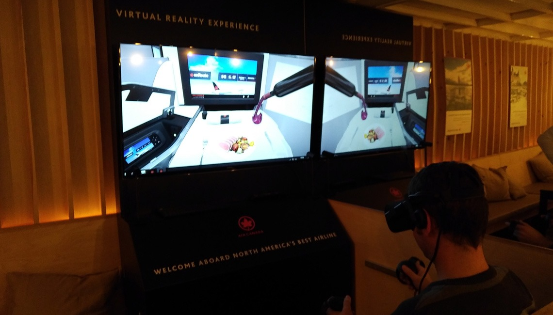 A man wearing a VR headset and a screen showing his virtual flight experience.
