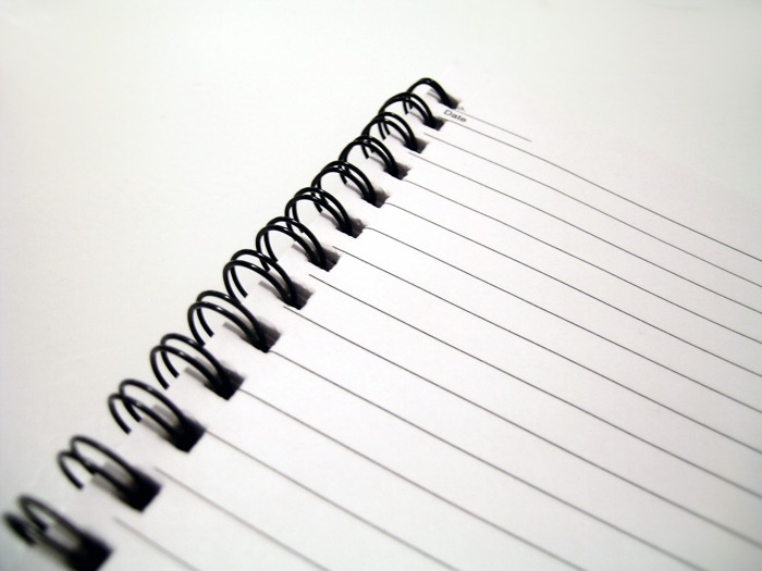 An empty, spiral-bound notebook.