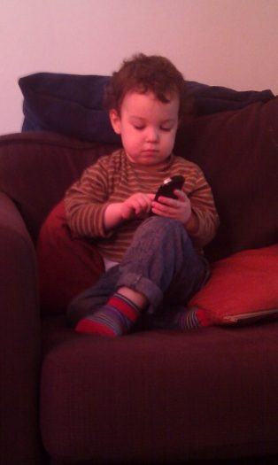 A child playing with a phone. Silent Sunday #3