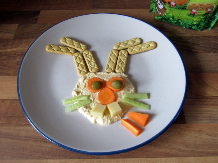 A toddler's lunch rearranged into the face of a rabbit.