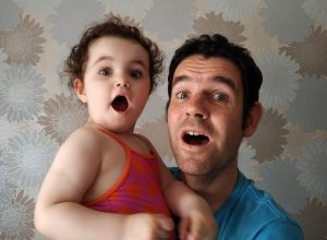 A father and daughter pretending to be surprised.