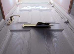 A view of a letterbox from floor level to suggest a thud on the doormat.