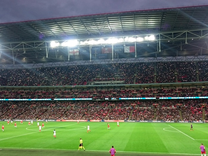 Inside Wembley Stadium during an evening match.