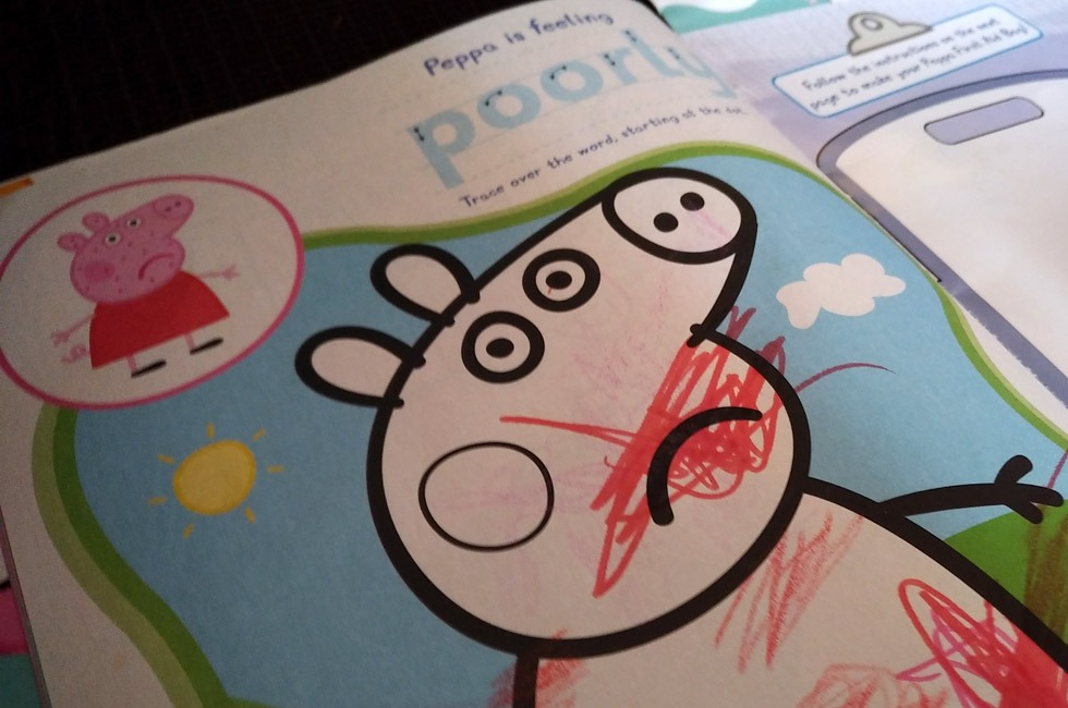 A picture of Peppa Pig that has been scribbled on by a toddler.